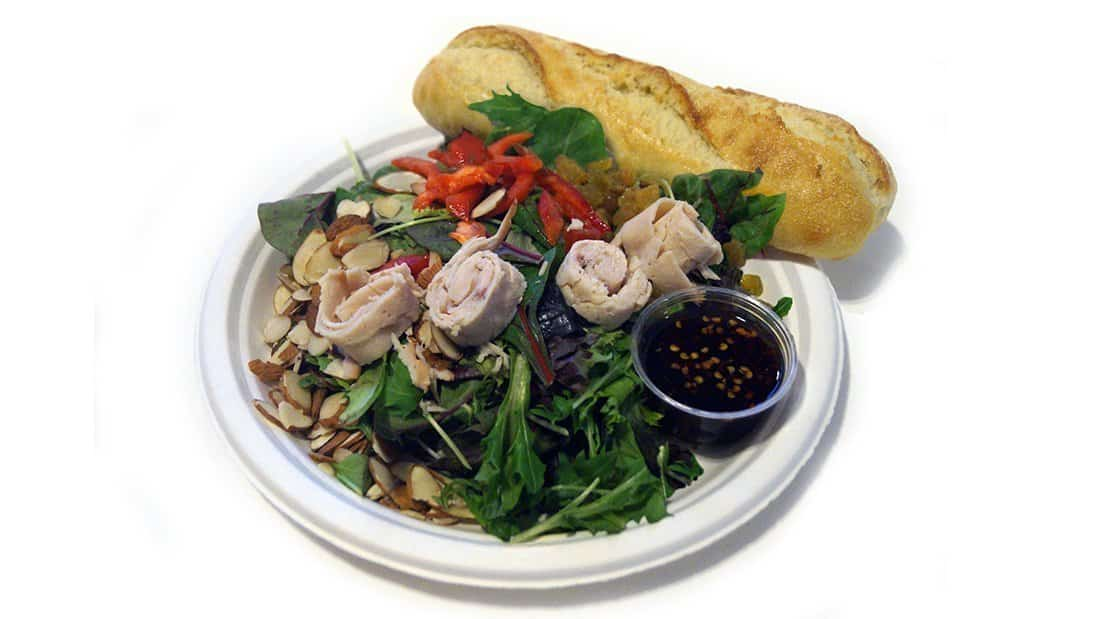 Asian Salad: mixed greens, roast turkey, red and yellow bell peppers, golden raisins, and almonds with Asian dressing.