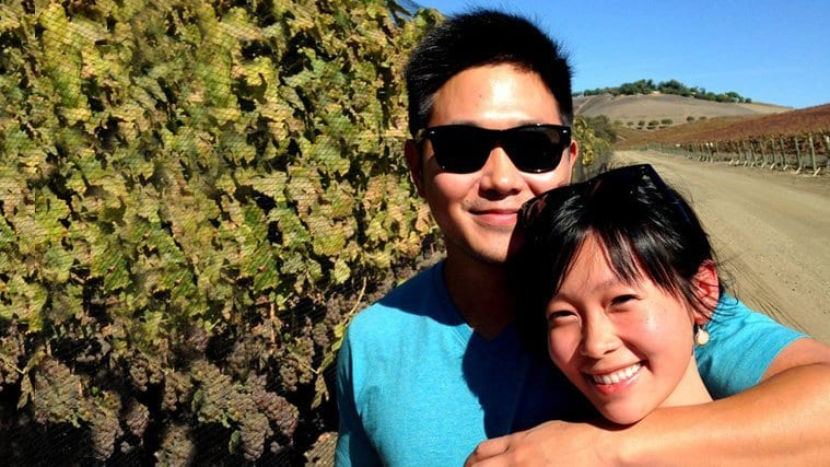 A couple in the vines on a Wine Lovers Tour.