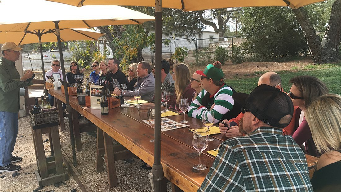A large group of friends tasting wine