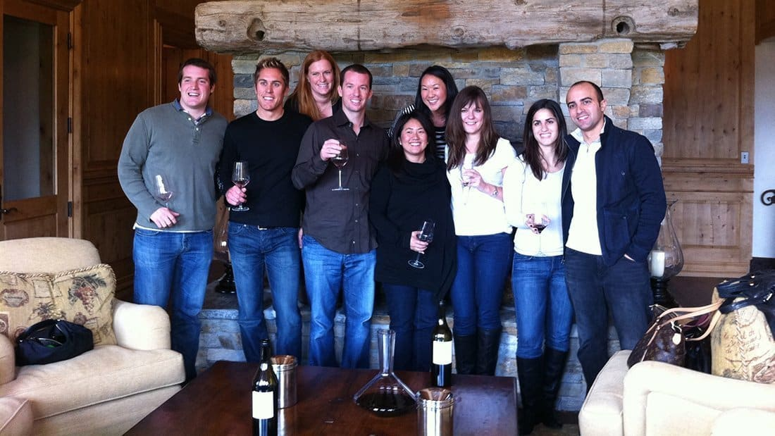 A Happy group of wine lovers tasting wine at a private estate winery.
