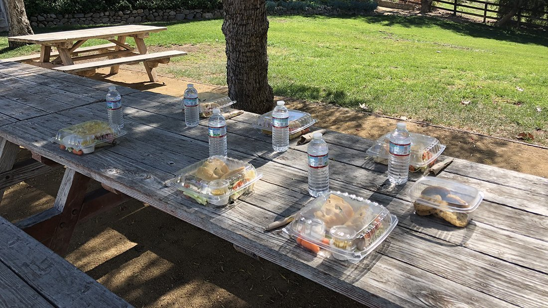 Lunches set outside at a winery ready for the guests.