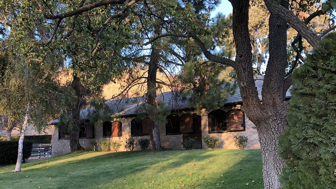 A private horse ranch barn, the setting of a private wine tasting.