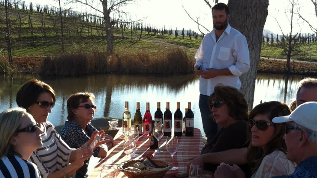 A private tasting held by a pond.