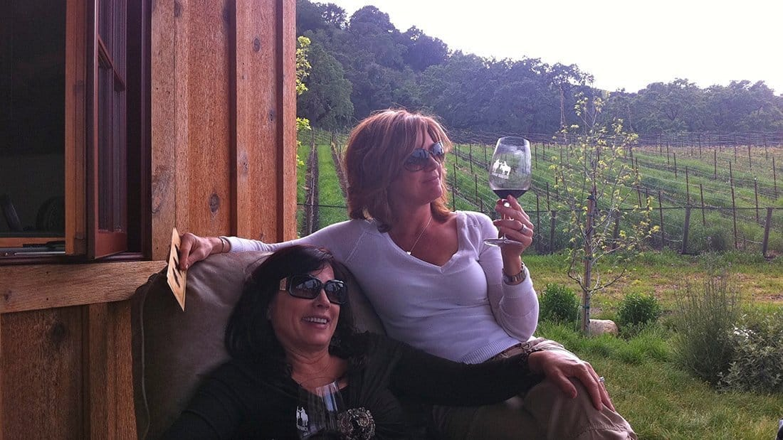 Two classy ladies enjoying the wine and views.